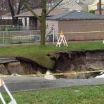 Storm rips opens Chicago sinkhole; driver injured