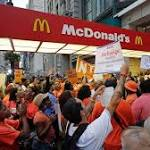 Fast-food restaurant workers march to demand $15 an hour