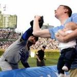 Watch: Father Catches Foul Ball While Holding Baby At Wrigley