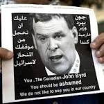 'Baird you are not welcome in Palestine': Protesters hurl eggs and shoes at ...