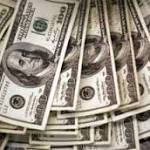 Dollar Rises as Fed Reduces Bond Buying Amid Growing Economy