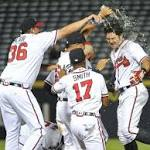 Braves rally past Reds in 13th for 9-8 win