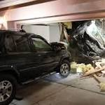 SUV sails into garage – through the roof