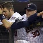Dozier plays hero in Twins' extra-inning victory