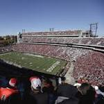 Lawmakers in football-obsessed Ga. enjoy last freebie football tickets before ban