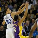 Lakers play Golden State tough but fall to Warriors