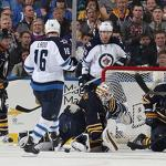 Jets edge Sabres to continue playoff push