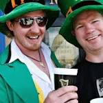 Enthusiastic crowd lines Dublin streets for St Patrick's Day