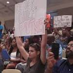 Furious over Scott shooting, crowd assails Mayor Roberts and City Council