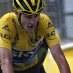 Froome survives hailstorm of attacks to keep Tour de France lead