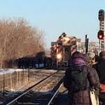 Man Climbs On Top of Metra Train, Delays Commuters