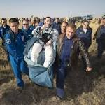 Soyuz capsule brings 3 back to Earth from space station