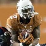 Two UT receivers suspended, charged with sexual assault
