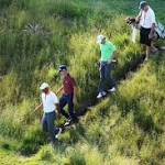 Tiger Woods shakes off wrist pain, shoots 73; Phil Mickelson's lead holding up in ...