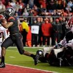 Nova throws 2 TDs to Carroo, Rutgers bowl eligible