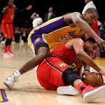 Hawks get balanced scoring in trampling Lakers 106-77