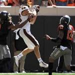 Oklahoma St. moves on from controversy, addresses run game