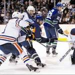 Canucks fire on all cylinders, overpower struggling Oilers