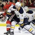Blackhawks score four in third, beat Sabres in home opener