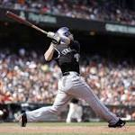 Justin Morneau's big hit gives Rockies 8-7 win vs Giants