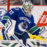 Canucks re-sign Bachman, a goalie to expose in expansion draft
