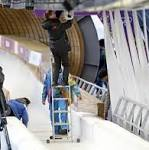 Olympic worker struck by bobsled breaks both legs, may have concussion