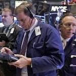 U.S. Stocks Drop as Data, Profits Fuel Fed Taper Bets