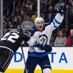 Jets score on first 3 shots, then edge Kings in shootout