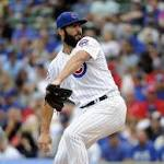 Jake Arrieta fans 10, Cubs down Cardinals for 98th win