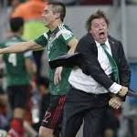 Mexico boss Miguel Herrera celebrates wildly on one of the happiest days of his ...