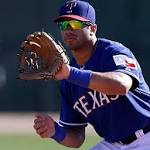 Russell Wilson a hit with Rangers, keeps baseball dream alive