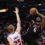 Heat stay in gear as LeBron James flirts with triple-double