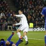 Real Madrid grabs top spot in group; Atletico advances