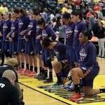 Catchings, entire Fever team kneel during national anthem