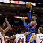 Deng scores 29, Heat click in 2nd half to beat 76ers 119-108