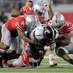 Barrett, Elliott lead Buckeyes by Bearcats, 50-28