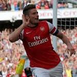 Giroud's strike sinks big-spending Spurs