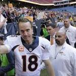 Peyton sets TD pass record, Denver clinches