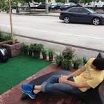 Pedestrians take over 20th Street for Park(ing) Day
