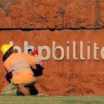 BHP Billiton tipping an iron slide. Photo: Reuters