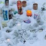 Boy, 17, held in shootings at home, school in Canada