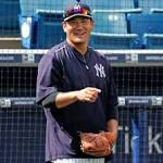 Yankees' Tanaka tosses without pain