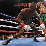 WBA middleweight champ Jacobs stops Quillin in 1st round
