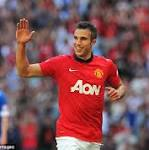 Manchester United 2 Wigan 0: Van Persie double claims first silverware for Moyes