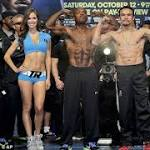 Juan Manuel Marquez and Timothy Bradley weigh in for WBO welterweight title ...