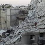 Syrian forces pound rebel-held areas of Homs