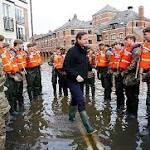Cameron defends flood defence spending amid calls for 'complete rethink' - live