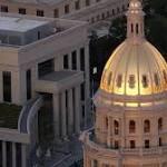 Gov. John Hickenlooper defends human services director Reggie Bicha