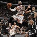 Deron exits with calf strain as Nets fall to LeBron, Cavs
