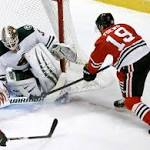 Chicago holds off Wild rally